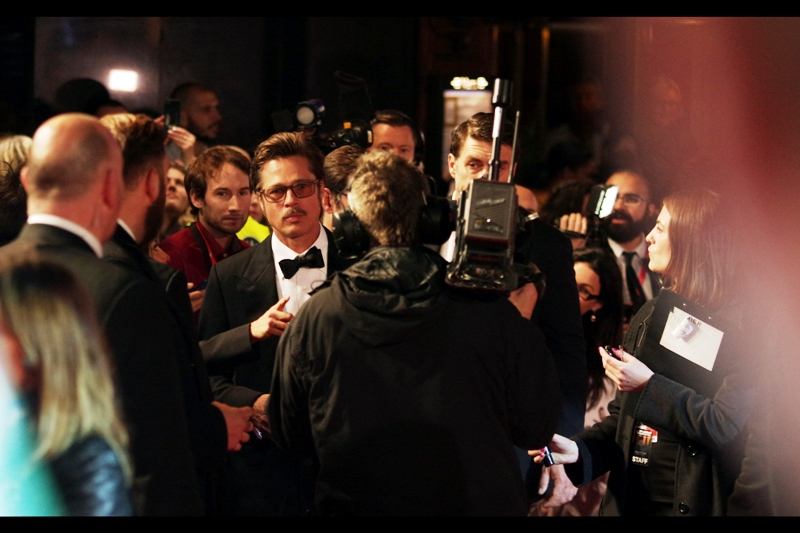 Brad Pitt and I share a moment, but it wasn't enough for me to get an autograph on a photo I'd taken at the Baftas in 2012 when we shared a slightly different but somewhat related moment.