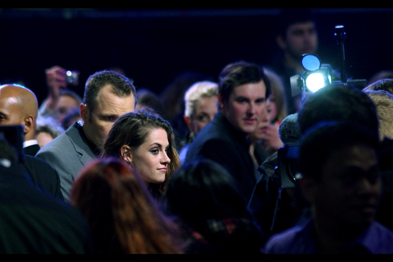 Kristen Stewart looks uncertain as to the situation of whether you're allowed to show up at your own premiere without a movie ticket and getting into the cinema.