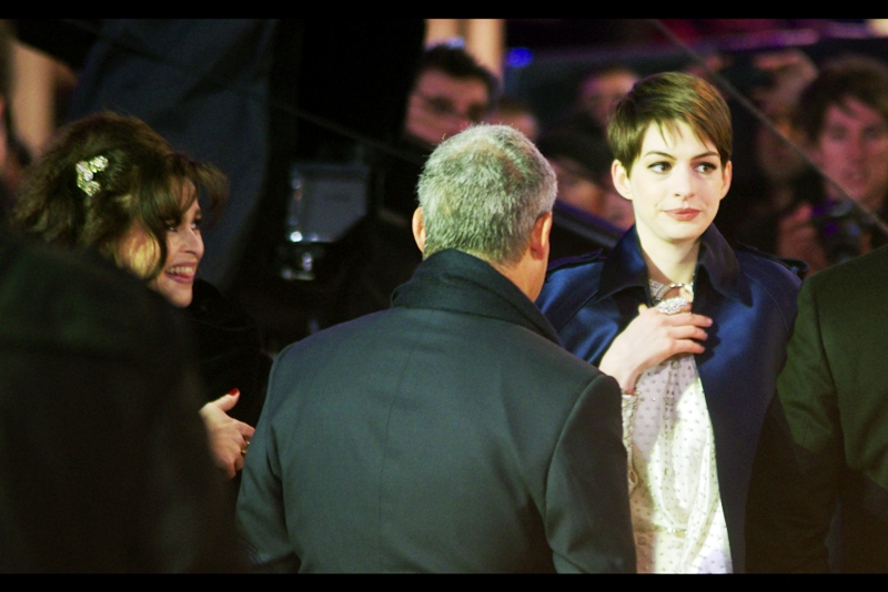 Helena Briefly interacts with Hathaway, who is heading towards the stage. I'm going to admit that I'm wearing approximately five layers of clothing (including two thermal and one insulated). And I don't think what Anne Hathaway is wearing technically counts as one layer yet.