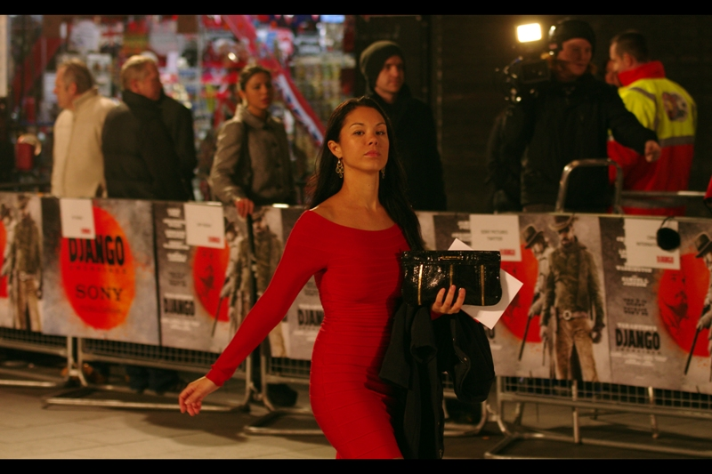 By this time Kerry Washington had gone into the cinema, and everything had (sadly) calmed down a bit. So... here's a lady in a red dress. A few frames later she gave a half-smile in my direction, but if I'm honest I don't mind the pout. No idea who she is.