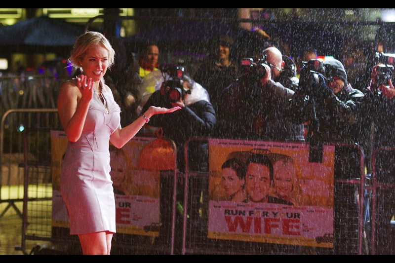 """Is it raining or sleeting?""  I don't know. Either way, it was cold. Her name, per wireimage, is the improbable ""Aisleyne Horgan-Wallace"". Incredibly not even one of those names appears in the cast listing of this movie. And weirdly, that cast listing DOES include Dame Judi Dench, who plays a bag-lady according to the IMDB. She's probably out dispensing vigilante justice on the streets of London or illegally downloading thrash metal albums in preference to attending this shindig though."