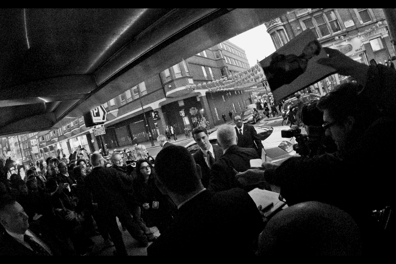 Matthew Goode arrives, and I've elected to bump up the ISO to something rather insane like 3200 (6400? One step down from charcoal sketching the event myself) to support just a little bit more depth of field. (Did I mention that the Samyang 8mm has no autofocus?) (It's a tricky little lens.. )
