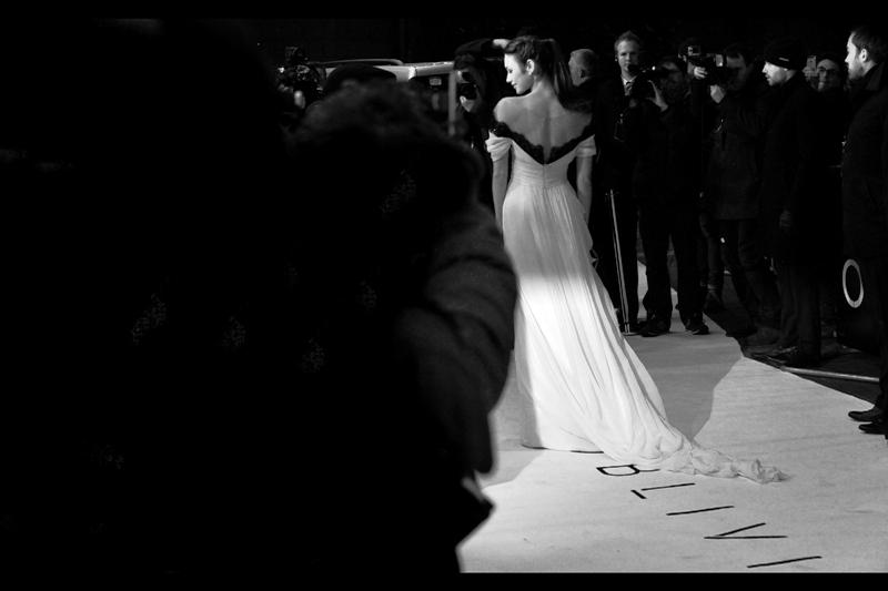 Olga Kurylenko's dress fits the white carpet quite well. (Even more so in black'n'white).