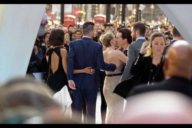 Benedict Cumberbatch arrives to the sound of a thousand urgently excitable female cheers, and promptly kisses Alice Eve. Well.... damnit. What the hell has he got that I don't? (Or more to the point, what other than two DSLRs and a website not run by my fans do I have that HE doesn't)