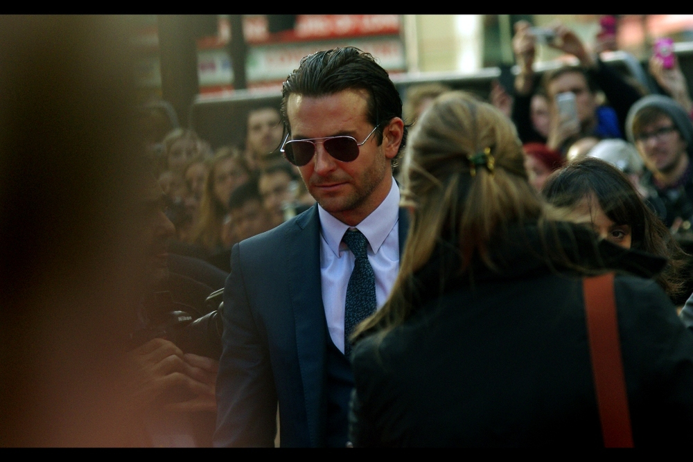 """I'mma pose here for two, maximum three minutes so you can all admire me. Are we cool?"" The man, the myth, the slicked back hair - Bradley Cooper has arrived."