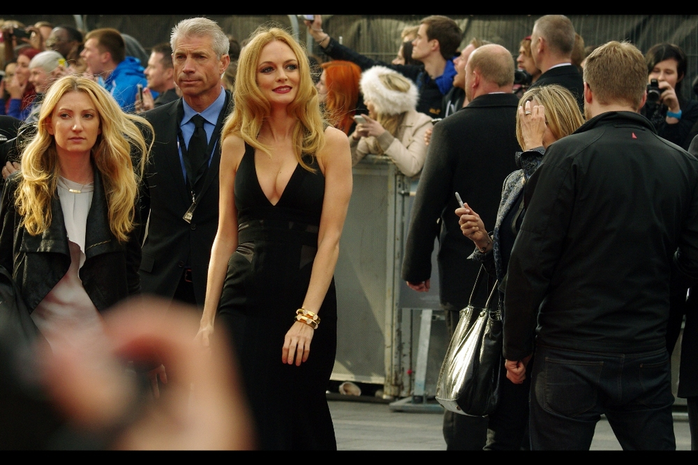 Actress Heather Graham momentarily stops to enjoy the trailer for the movie she's in