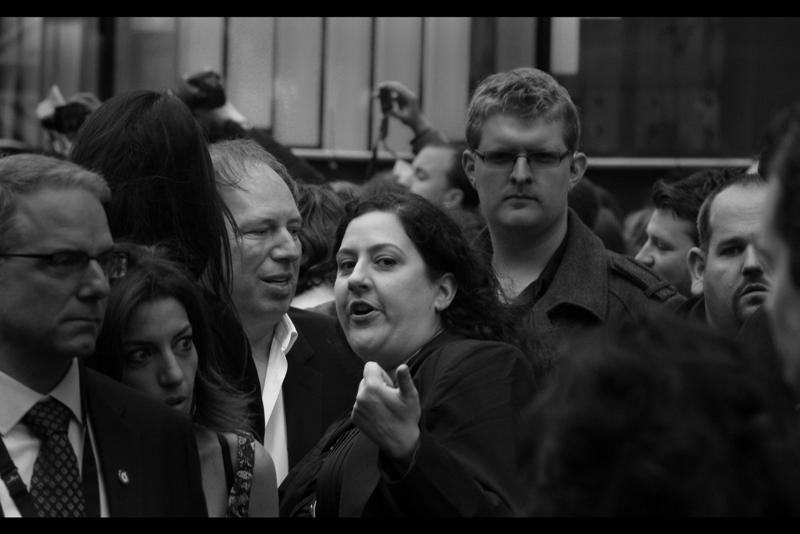 """There's a guy over there. Says he loves you"".  To clarify : I just love HIS WORK. Big difference, but composer Hans Zimmer to her right is pretty awesome. It's not every composer whose arrival is LOUDLY announced as he gets out of his chauffeur driven Merc at a premiere. (Most film score composers don't go to premieres. Which is sad)."
