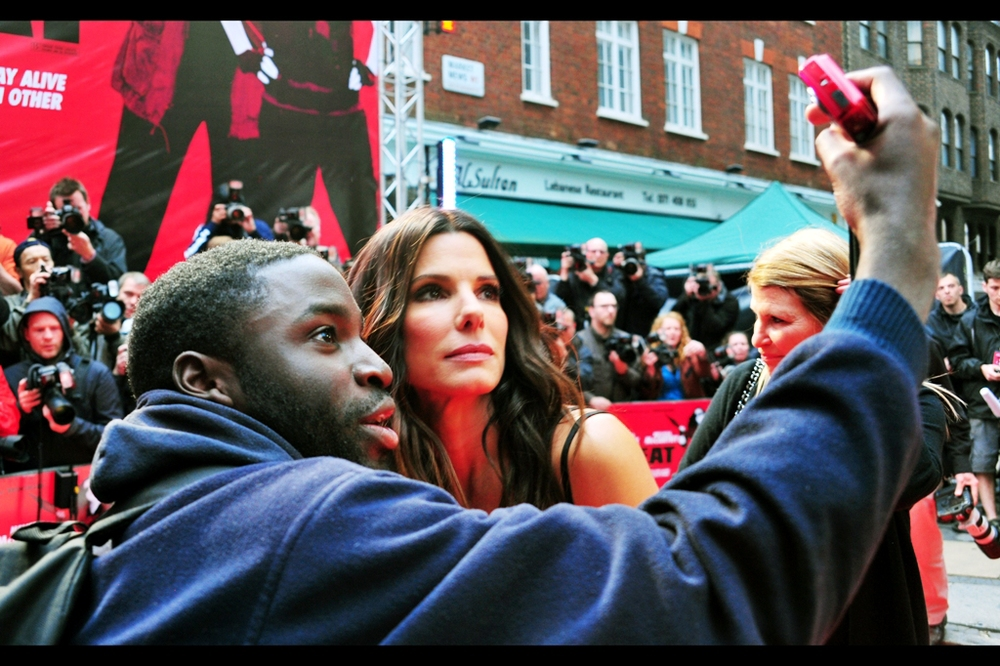 "When presented with her biro sketch by my new friend, Sandra Bullock said  ""I'm sorry, but I can't accept anything"" . However, she did allow herself to look worried (or fascinated) in a photo with him."