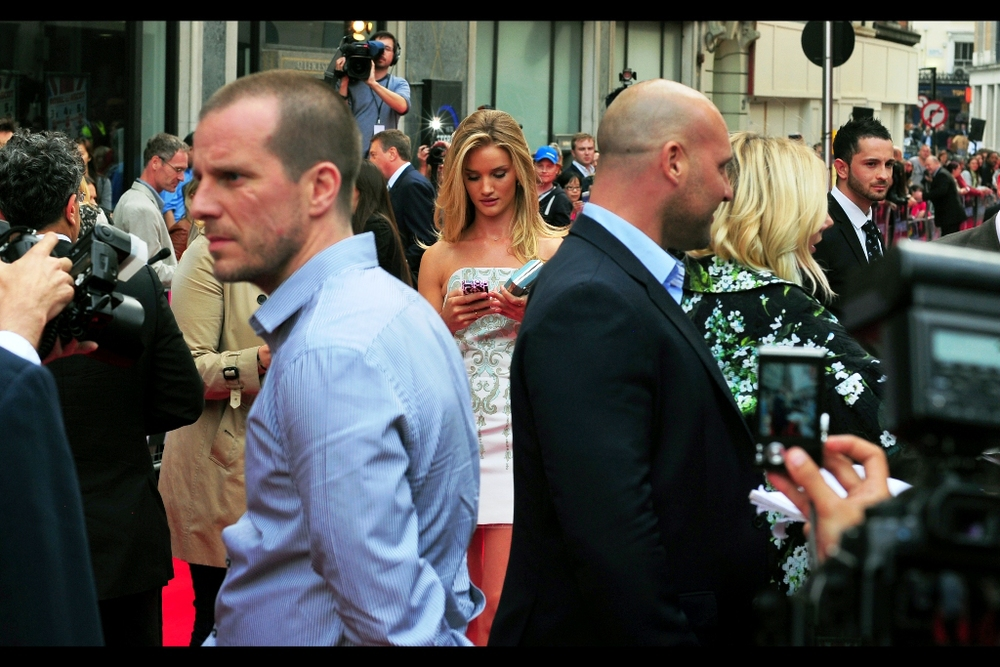 "I think I've been to four (three?) previous Jason Statham premieres, at each of which the fans and paparazzi were like ""Yeah, Jason Statham is totally awesome..... but do you think his model girlfriend will show up, cause with all due respect she's way hotter"". Fans and Paparazzi tend to me male, it bears mentioning. And here she (finally) is! Rosie Huntington-Whitely."