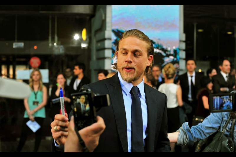 I'm not familiar with the works of this man, but he's Charlie Hunnam, and the screaming of the female members of the crowd suggest that maybe I should be. Apparently he's a long time actor in Sons Of Anarchy. Whatever that's about.