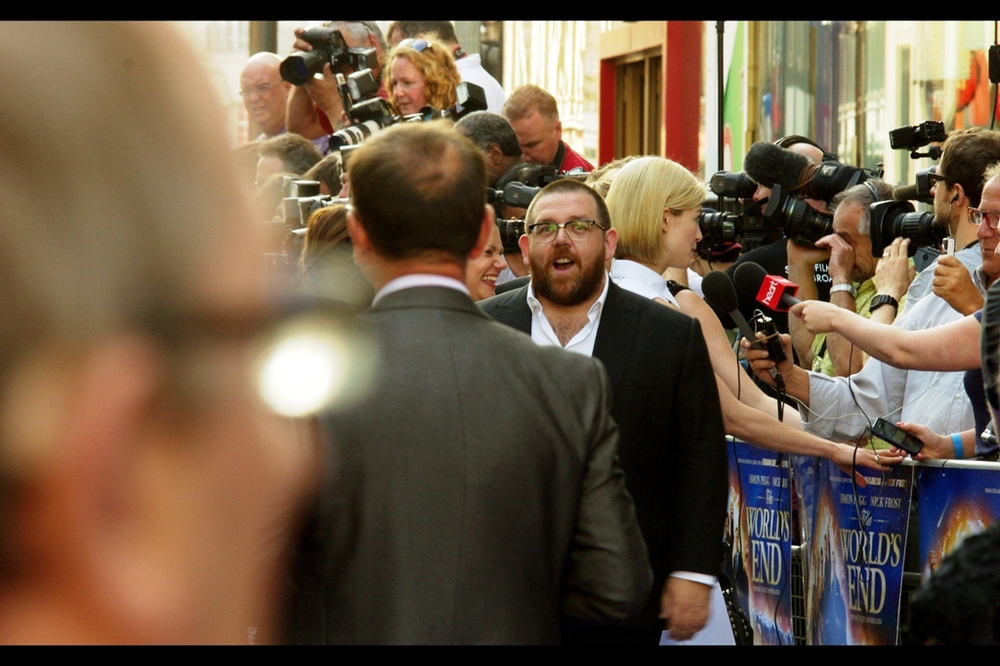 "Meanwhile on the other end of the blue carpet, Nick Frost. I think he's now done every variation of hair and beard/moustache other than short hair and clean shaven. Per imdb his next movie is ""Cuban Fury"" so I'm looking forward to that premiere to see if he can mix it up further."
