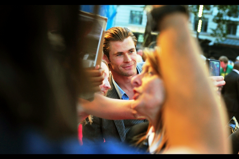 "Time to reinsert the earphones they handed out for when the F1 cars arrived - it's Chris Hemsworth!! I've photographed him before, most recently with Charlize Theron and Kristen Stewart at  ""Snow White and the Huntsman"""