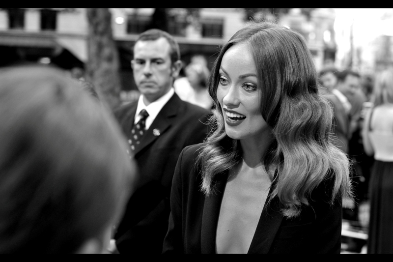 """You've got a poster of me on your bedroom wall? That's... awesome. I don't have a poster of you on mine. Or of myself either.""  Olivia Wilde makes a connection. Sadly with somebody who is not me."