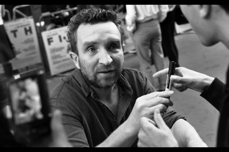 """It's not a ring, but the ink flow is really good. Will you do me the honour...?""_ Eddie Marsan plays the hapless Inspector Lestrade in the Guy Ritchie  ""Sherlock Holmes"" , and was also in  ""War Horse"" ,  ""Snow White and the Huntsman"" ,  ""Me and Orson Welles""  and  ""Hancock"".  I didn't photograph him at all those premieres, but nice to know he's been a presence since the very first (Hancock)"