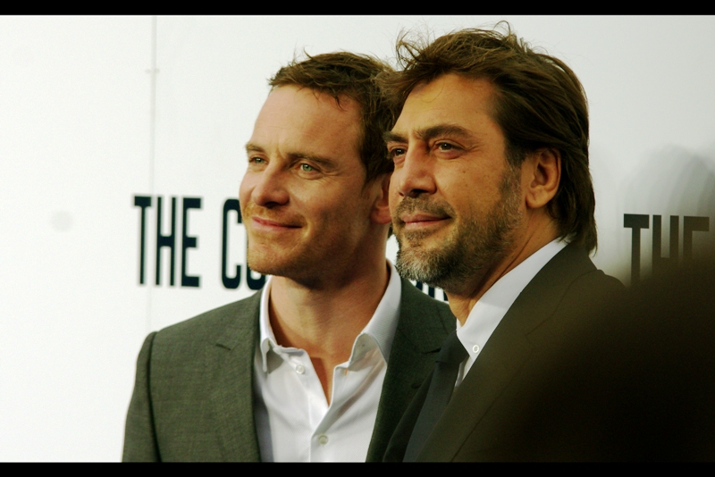 Friends again. (Because Michael Fassbender's Cool does not take offense at Javier Bardem's charisma. Or superior stubble).