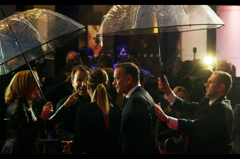Sure, Tom Hanks has won two Acting Oscars and been nominated for a further three, but let's hear it for the brave men (and sometimes women) who hold up umbrellas for the actors at these premieres. And occasionally place their hands upon stars' backs. It's a living.