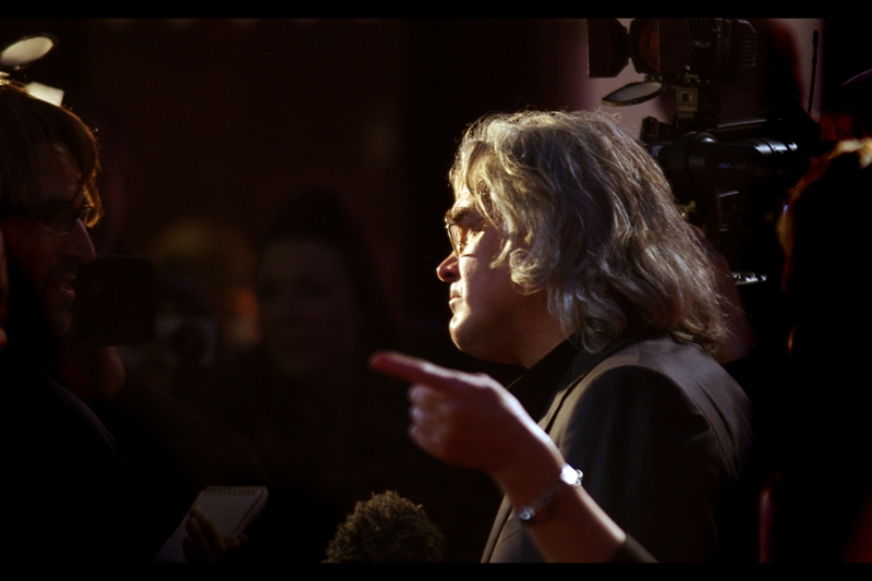 "Good news. A sightly more profile-esque shot of Paul Greengrass, who is big enough a director nowadays to have hired somebody to point exasperatedly at people who ask him silly questions. (""No I don't like sultanas. Who does, honestly??"")"