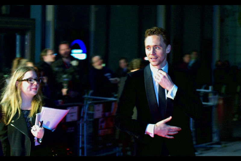 """Well, time to look all awesome and stuff""  Tom Hiddleston heads off to pose for the paparazzi."