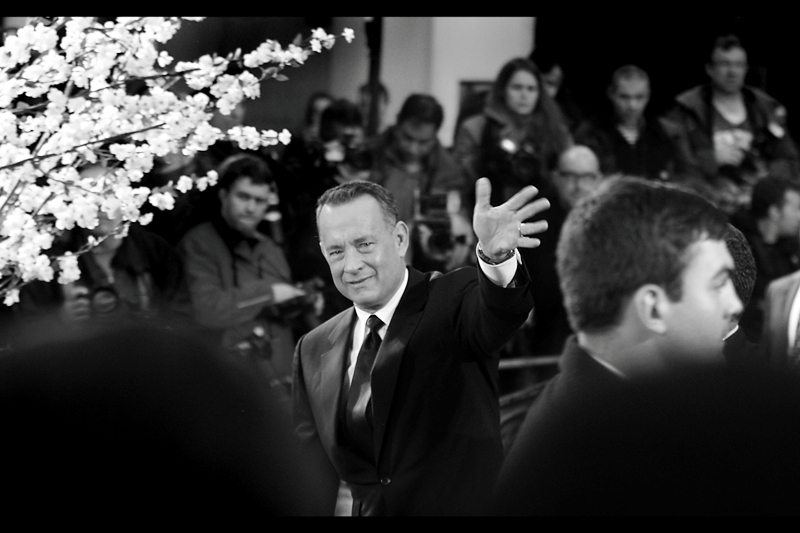 Unlike Will Smith, Tom Hanks prefers to dispense high-fives remotely. It is more efficient, I guess.
