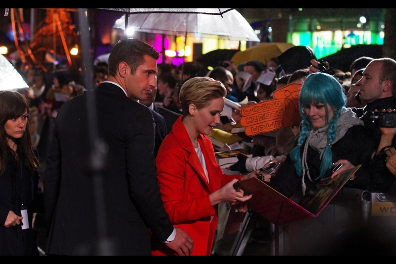 Jennifer Lawrence signs autographs, and possibly proofreads implausible Hunger Games fanfiction.