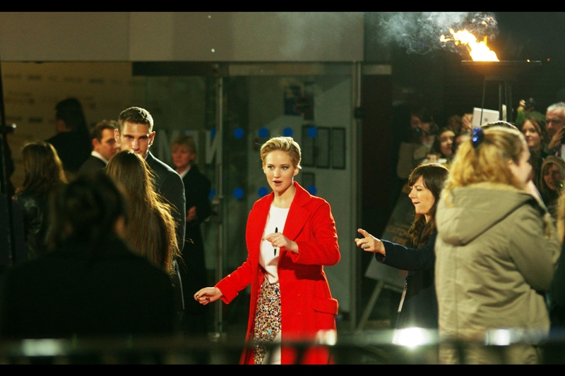 """You're going to make a 'catching fire' comment with the flames behind me, aren't you?"" No. I was just... looking at the coat. It's a red coat."