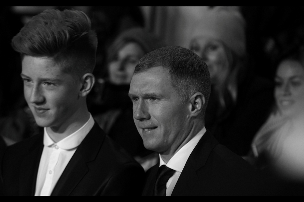 I was going to say that it was sweet of the OneDirection bandmember to bring his Dad/Uncle to the premiere. Turns out it's the guy in front who is famous : he's Paul Scholes, and that's his son. Paul Scholes played for ManU from 1993-2013, retiring for the second time this year.  Wow. I'm roughly his age and haven't even retired once, yet.