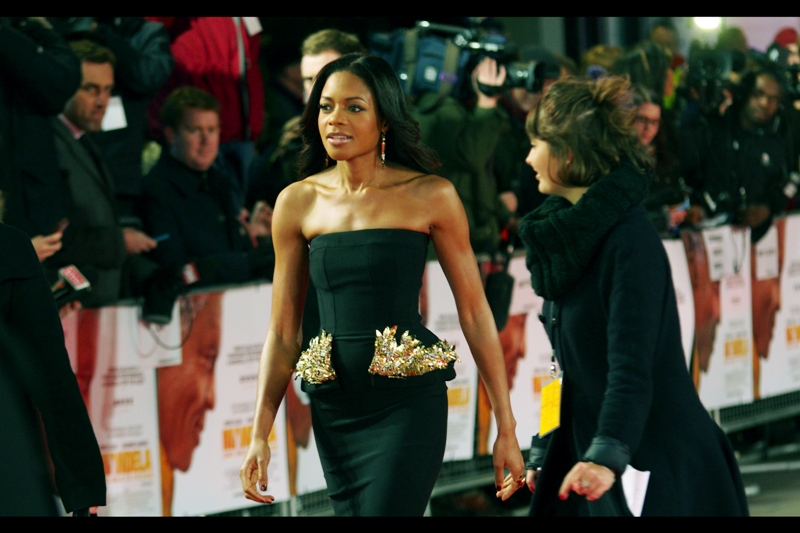 "Naomie Harris storms up the red carpet to pose for Paparazzi before returning to interview duties and autograph signings. She was most recently Miss Moneypenny in the latest Bond film ""Skyfall"" whose premiere remains one of my favourites, even though it got many fewer views than any event Tom Hiddleston has ever been in."