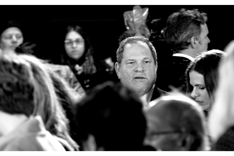 TWC Studio boss Harvey Weinstein is awash in a sea of commoners (poor guy).