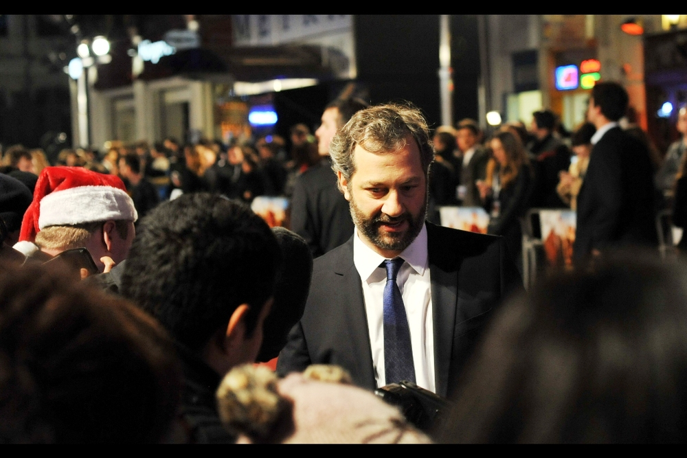 """Your hat with the ears has charm, but the guy with the Santa hat REALLY put in some effort, so I'm not signing that. You can have a high-five though?"" Judd Apatow has arrived."