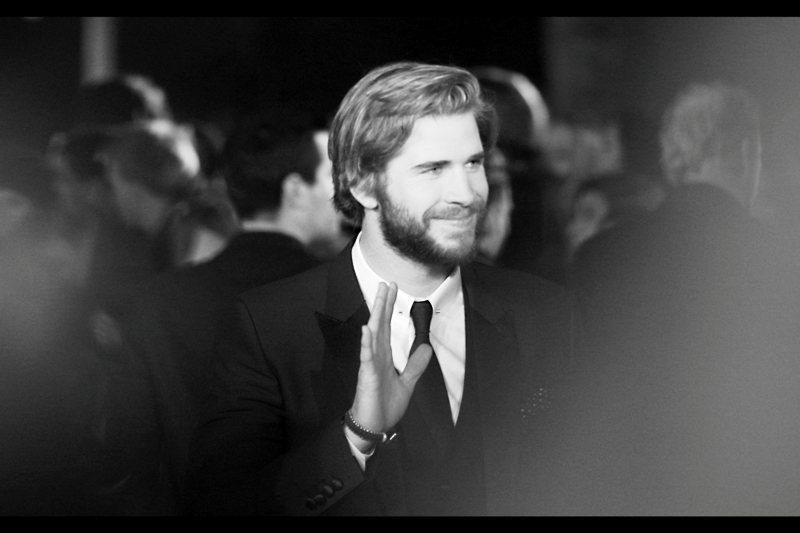 "Liam Hemsworth gets within camera-foussing distance, which is all the invitation the French Guy in front of me needs to start waving his giant "" sign me, I'm from Paris "" folio like some kind of crazy... guy... from Paris. ...."