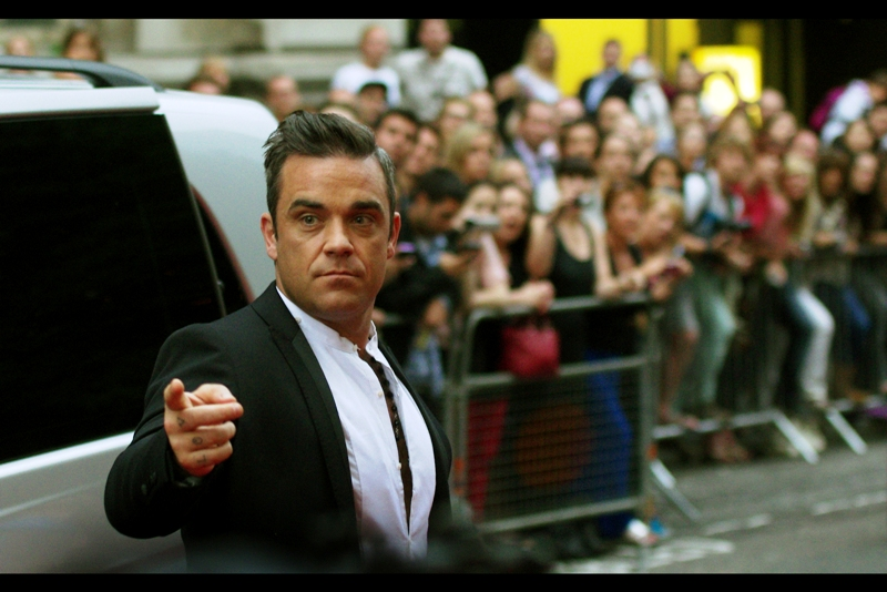 "Attendee quality is slowly rising : Robbie Williams! Known for : Singing. Being in Take That. Leaving Take that. Reuniting with Take that. Returning to Solo career. He won the ""Icon"" award at this year's award. Icon. I heard that word said about three different things at  yesterday's ""The Sweeney Premiere"""