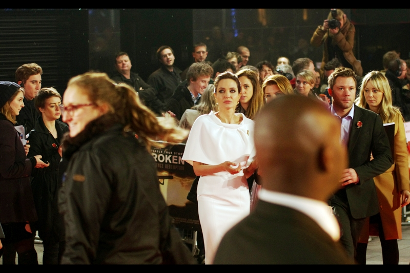 And some days, incredibly that same bald head is also on the right to block an alternative possibility of a decent shot of Angelina Jolie...