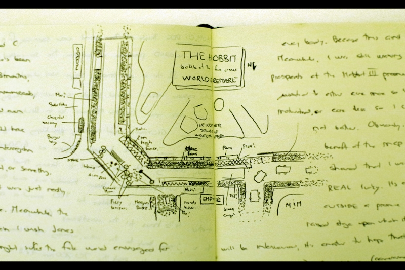 I do this for most premieres : draw a small sketch map... but for this one it seems particularly appropriate since Map Porn is a bit of a feature of Lord of the Rings.. My position ('Me!') is at the bottom, about a centimetre in from the middle fold, and then an arrow shows where I am. That white rectangle is a model of a London Bus 'artwork'. For the purpose of scale, a typical full-size premire would be less than half this size.
