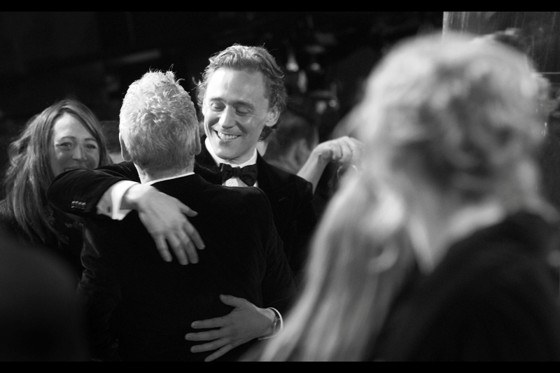 Actor, gentleman, and allegedly awesome erotic poetry reader Tom Hiddleston hugs a director.