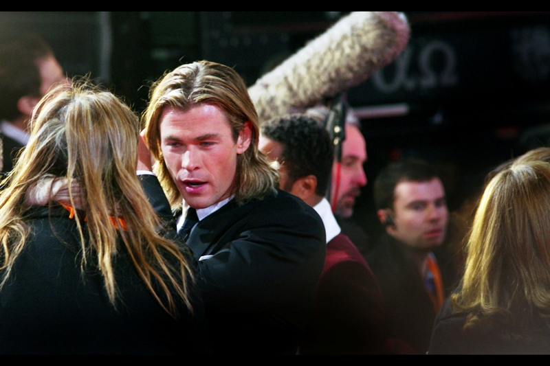 "Aussie actor Chris Hemsworth is rocking the long hair, but probably worries about his assistant overshadowing it. He was last photographed in Sydney at the World Premiere of ""Thor"" where my DSLR broke just beforehand and I had to use my Nokia. Different city, different camera, and he's got less stubble now…"