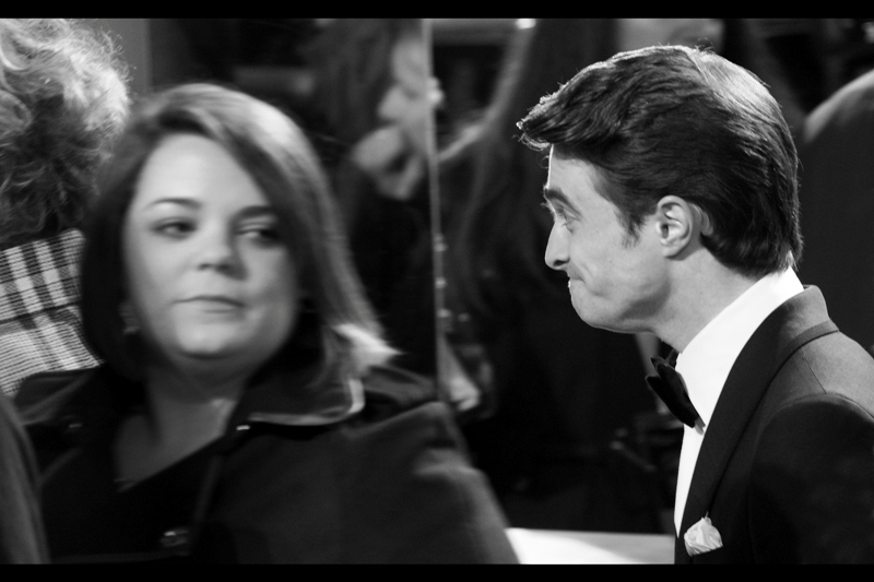 Daniel Radcliffe meets a fan (?) on the red carpet and my sub-genre of 'shots of the left side of peoples' faces' continues.