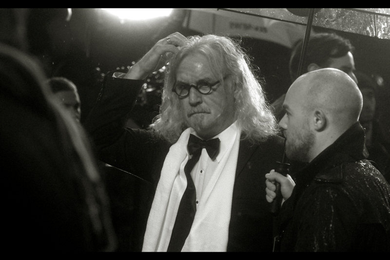 "Man on Right :  ""Dude, do you know that everytime you scratch your lustrous silver hair you make me feel a little worse about myself""  Billy Connolly has arrived. Last photographed at  the Premiere of ""Quartet"""