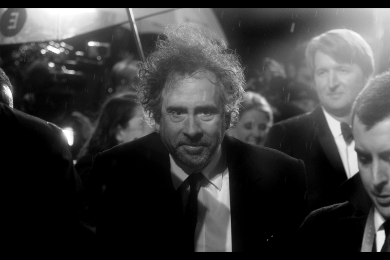 The rain is coming down harder and colder, and the Notables keep arriving. Director Tim Burton attempts to hypnotise me. And is not wearing glasses, sun- or otherwise, to this event. Odd.