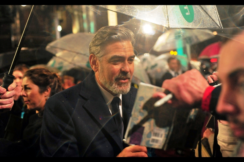 George Clooney isn't sure what that picture is meant to represent. Also : weird lens flare art courtesy of waterlogged Nikon lens (The Joaquin Phoenix one is my favourite, followed by the upcoming Daniel Day Lewis one)