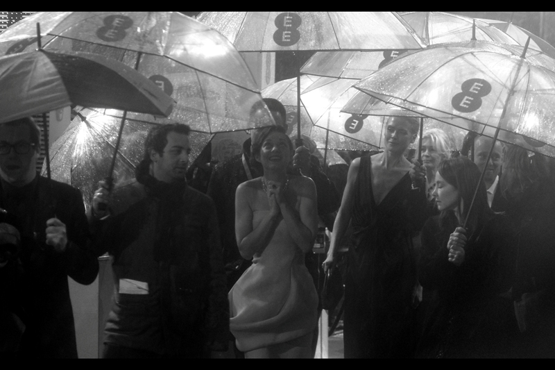 "Marion Cotillard enjoys her canopy of countless umbrellas. The dress was Yellow, in case you were wondering. She was nominated for a BAFTA for best Actress  in the movie ""Rust and Bone"""