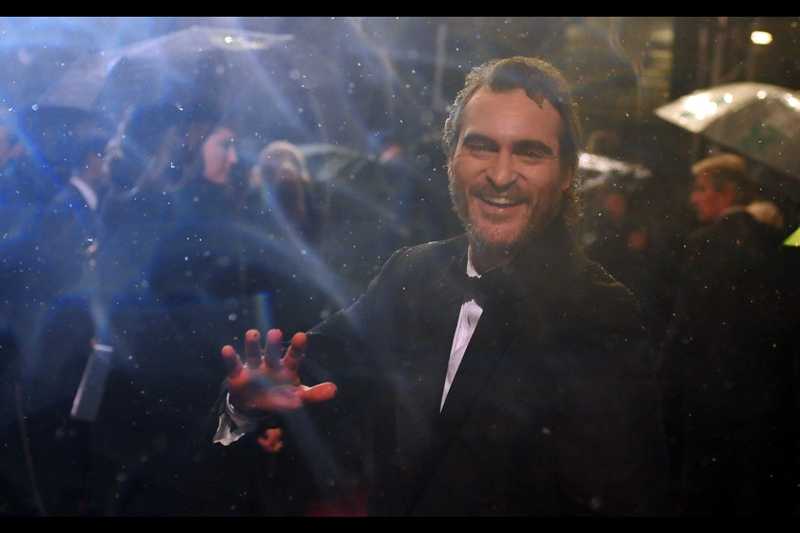 Joaquin Phoenix practices sleight of hand with actual practical effects. Either that or the Nikon's lens is possibly started absorbing water into its molecular componentry. I kind of like it in an artistic sense… but I think from an optical/engineering perspective it could be problematic.