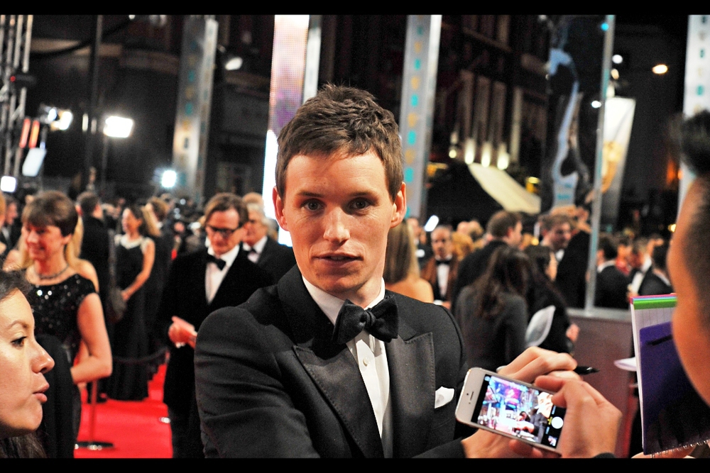 Eddie Redmayne (most recently in Les Miserables and Last Year's BAFTAS )and I have a staredown. I'm tired enough that I might have given him the five dollars he owes me.