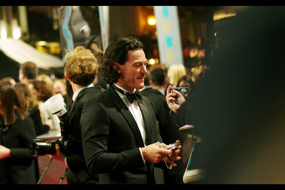 "I've never photographed Luke Evans before – he has a role in the last two ""Hobbit"" movies and was the bad guy in ""Fast and Furious 6"" . My beanie for the Baftas was less formal and less shiny than his bow tie, but also black. I try to make an effort."