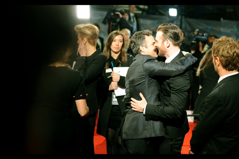 If this had been Tom Hiddleston hugging Benedict Cumberbatch, not only would I have been able to sell the photo and retire tomorrow, but the internet as we know it would have melted into a liquid, and then evaporated into gas and plasma from the heated fanfiction that would have resulted. And that would, I suppose, have been my fault for posting it. Still..  the lady in the background looks pleased.