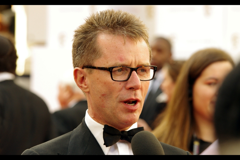 """Do I know who I am? Sure I do, but does that guy over there? Probably not"".  Well called. No idea who this is, but his bow tie is a hell of a lot straighter than the last guy, and that counts for a lot.  (Edited to add : Nicky Campbell)"