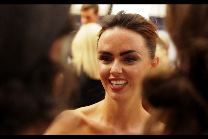 No idea who this is, but the collar-bone is attractive.  (Should I be allowed at this event? Should I give up my spot to somebody more worthy? Can collar bones be considered attractive? These are good questions you're/I'm asking...) (edited to add : Jennifer Metcalfe)