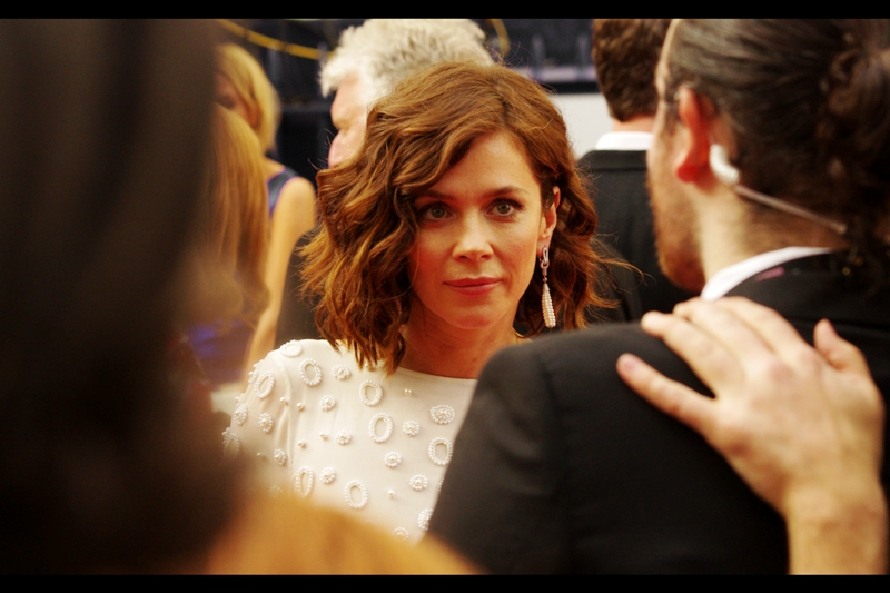 I don't know who this is, but somebody went to a lot of trouble to make those amoeba-style bumps on her dress. Or at least design them. Or designed a computer that designed them.  (edited to add : Anna Friel. Who I should have recognised, distracting micro-oragnisms-in-macro top or not)