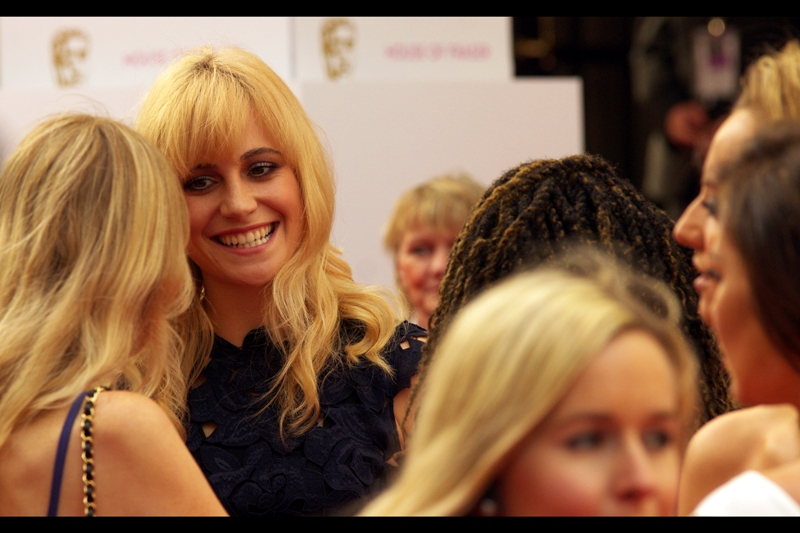 This is singer Pixie Lott, possibly still chewing the same bit of gum she was at The Olivier Awards a few weeks back. (I'm not being critical...most Dentists recommend chewing gum as part of an oral hygiene regimen)