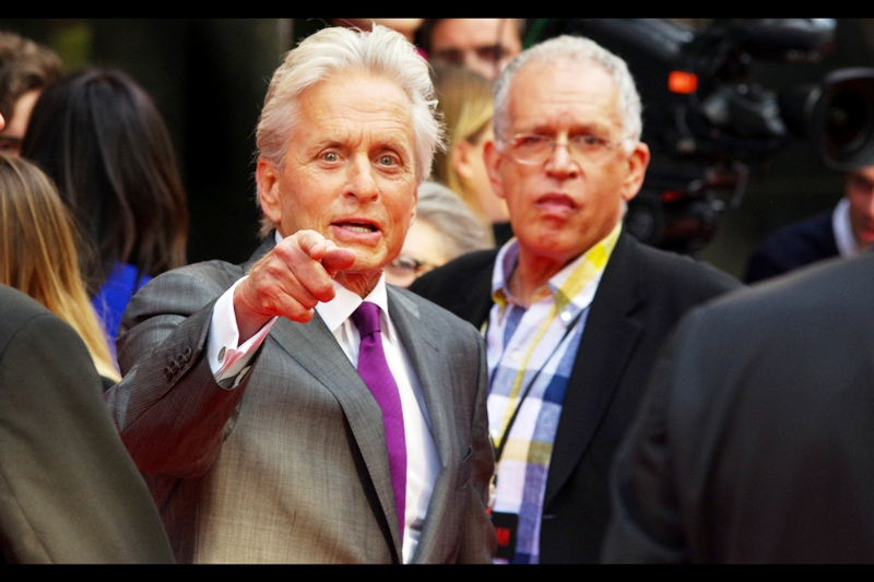 """That guy over there? I still owe him five dollars"" Michael Douglas' ....account-ANT (woo!) in the background doesn't seem so sure."