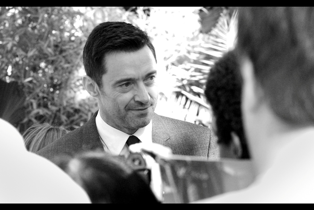 Australia's own Hugh Jackman arrives, to the insect-like clamouring of autograph dealers in our pen. Hugh didn't linger, and I couldn't blame him.